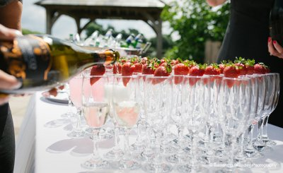 Serve champagne with fresh strawberries for a stylish and sophisticated drinks reception