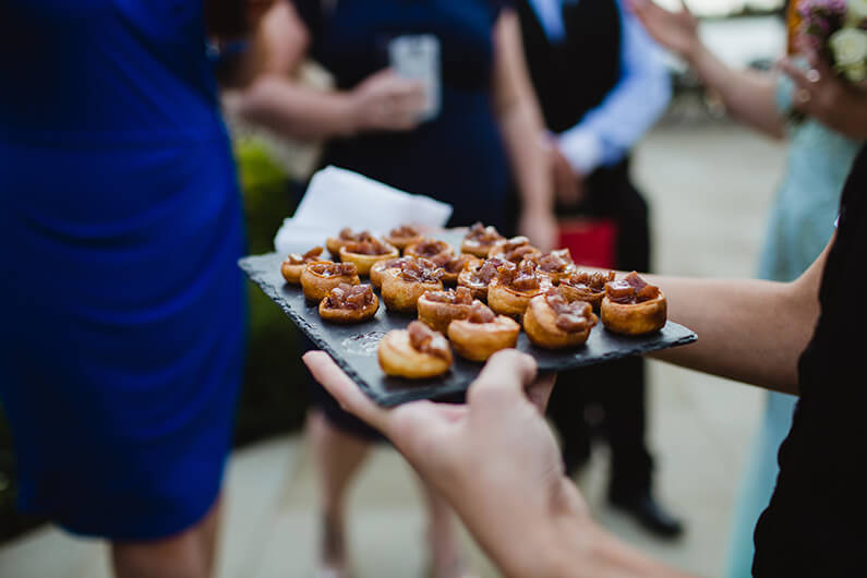 Canapes at the drinks reception in the courtyard at Sandhole Oak Barn