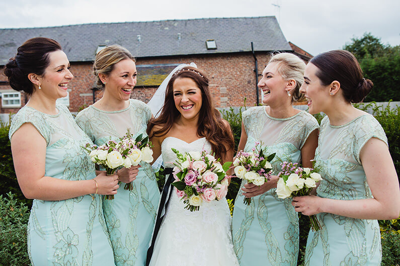 Claire and her bridesmaids in mint green dresses