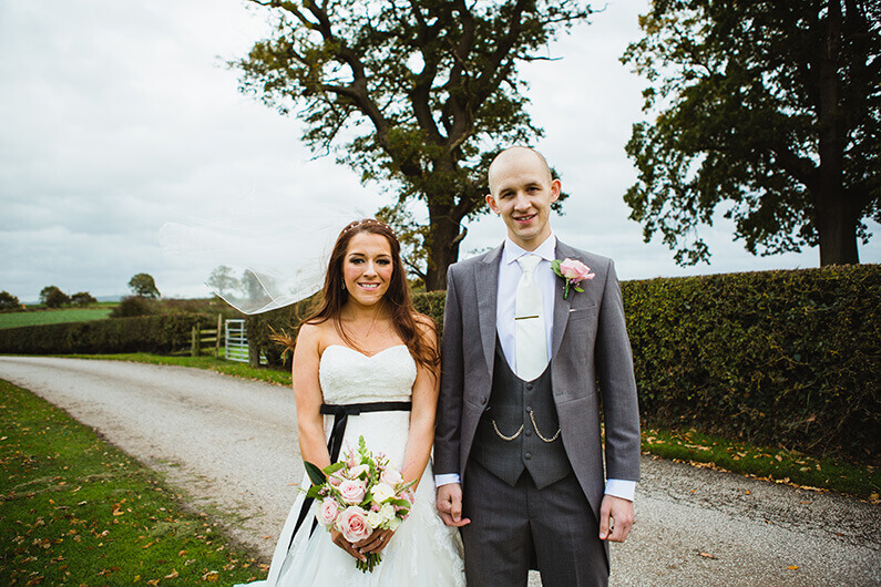 Claire and Sam in the lovely grounds at Sandhole Oak Barn