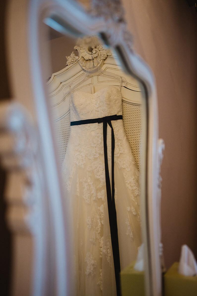 Princess style lace wedding dress hanging up