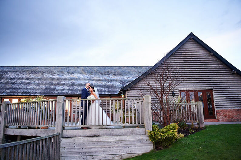 Exterior of Sandhole Oak Barn wedding venue at dusk
