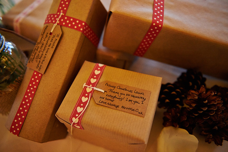 Christmas themed wedding favours with red ribbon