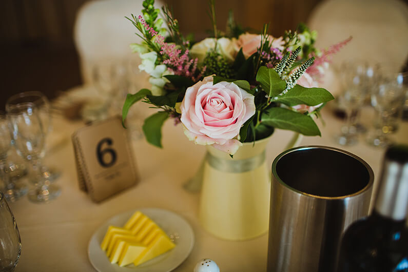 Pink and white table flowers with table number