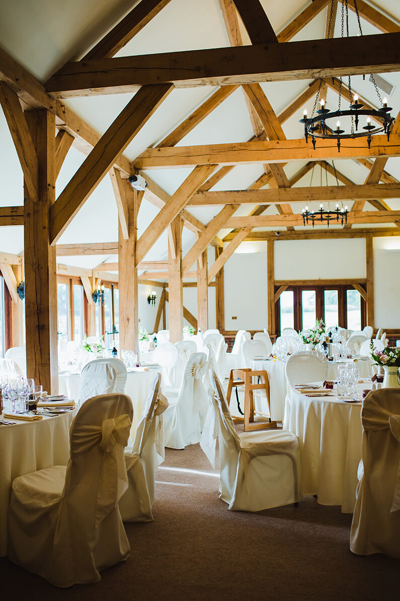 Beautiful barn set up with white chair covers