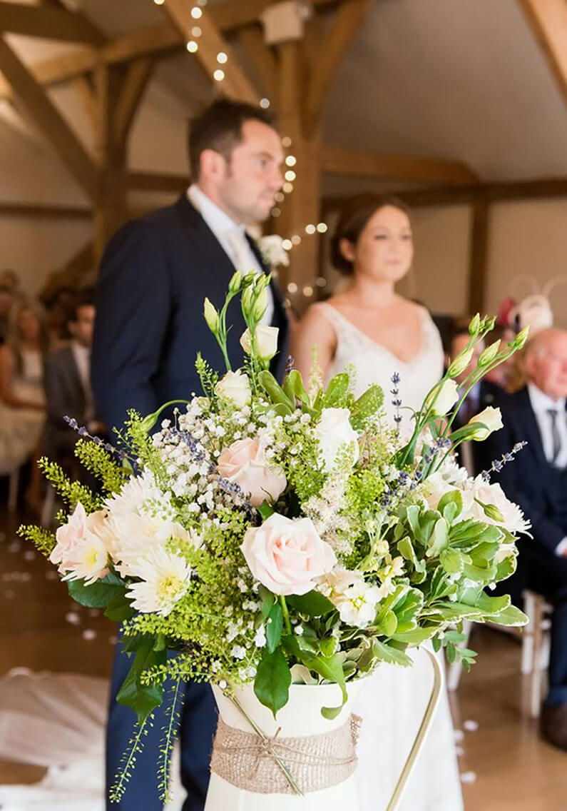 A gorgeous pink and white bouquet decorating the ceremony