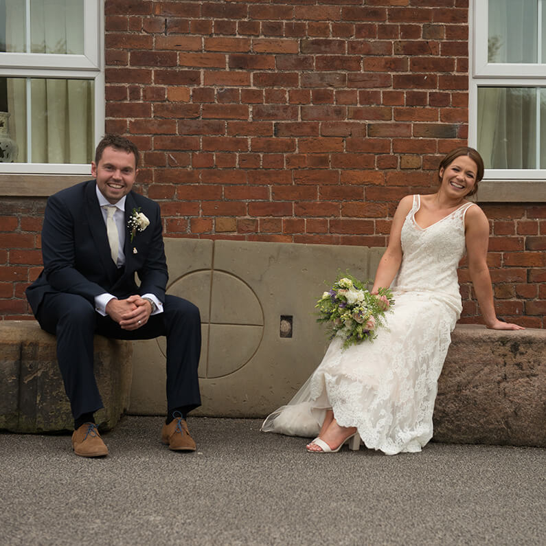 Chloe and Richard relaxing in the courtyard at Sandhole Oak Barn