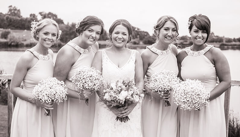 Chloe with her bridesmaids and pretty bouquets