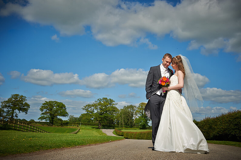 Tracy and Alex in the stunning grounds at Sandhole Oak Barn