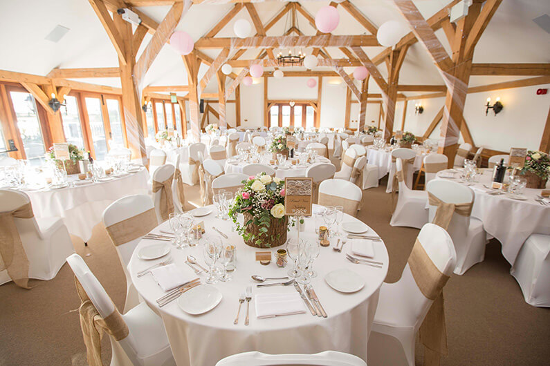 The barn decorated with pink and white flowers