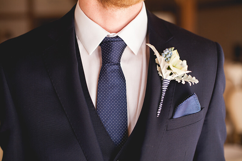 Danny's blue suit and cream & blue buttonhole