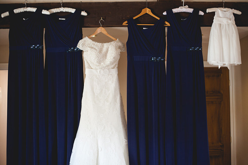 Lauren's white lacey dress and her navy bridesmaids dresses