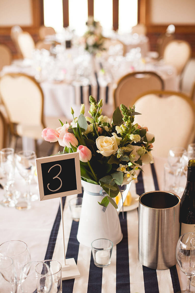 pink, cream and blue pastel flowers table centrepiece