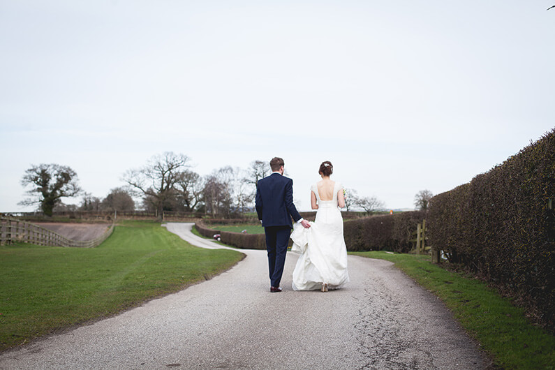 Lauren and Danny taking a stroll in the beautiful grounds at Sandhole Oak Barn