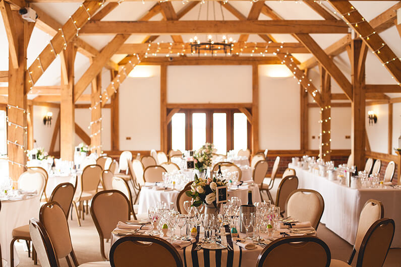 The rustic barn decorated in pastel flowers with navy and white stripes