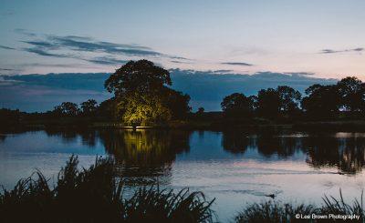 Sandhole Oak Barn outside wedding venue lake at night