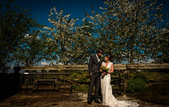 A happy couple stealing a moment at Sandhole Oak Barn
