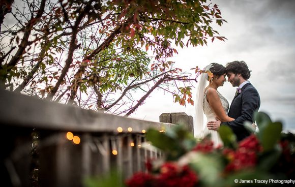 A happy couple enjoy the outdoor space at this country wedding venue