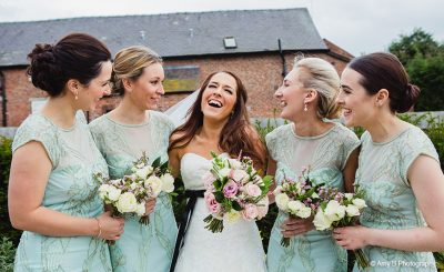 Mint coloured bridesmaid dresses are a glamourous choice for a country wedding