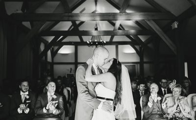 Bride and groom civil ceremony kiss