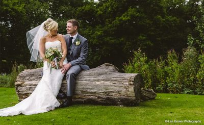Bride and groom steal a moment in the gardens at this exclusive use wedding venue