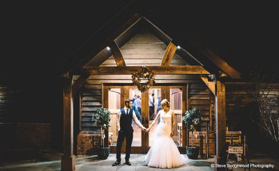 Couple share a moment outside during their evening wedding reception