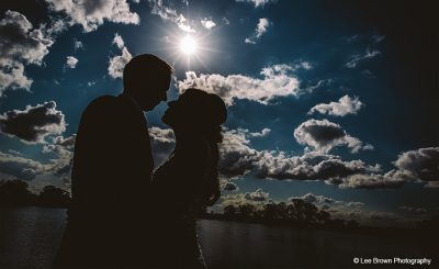 Bride and groom steal moment in sunshine