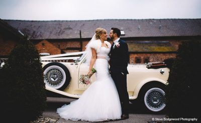 Bride and groom vintage wedding car