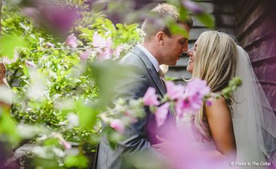 Couple steal moment at rustic wedding venue