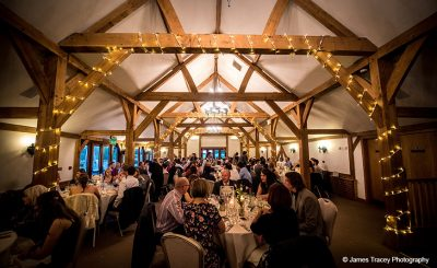 Guests enjoy wedding food at Sandhole Oak Barn wedding reception venue