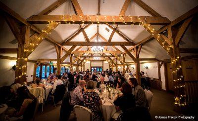 Guests enjoy wedding food at Sandhole Oak Barn wedding reception venue