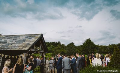 Guests enjoy a champagne wedding reception outside