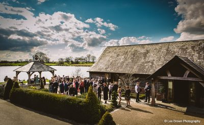 Guests enjoy a drinks reception at Sandhole Oak Barn winter wedding venue