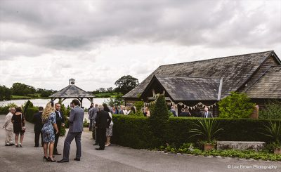 Guests await the arrival of the wedding party at this barn wedding venue