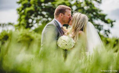 Couple stealing a romantic moment at Sandhole Oak Barn