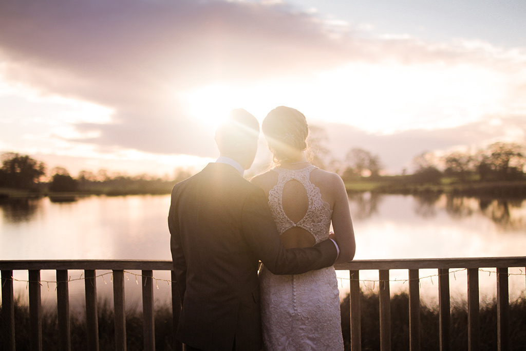 Kirsty and Richard watching the sun set at Sandhole Oak Barn