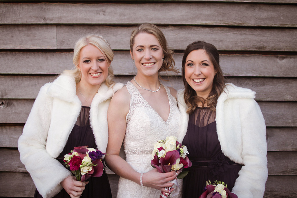 The bride and bridesmaids at Kirsty and Richard's wedding at Sandhole Oak Barn