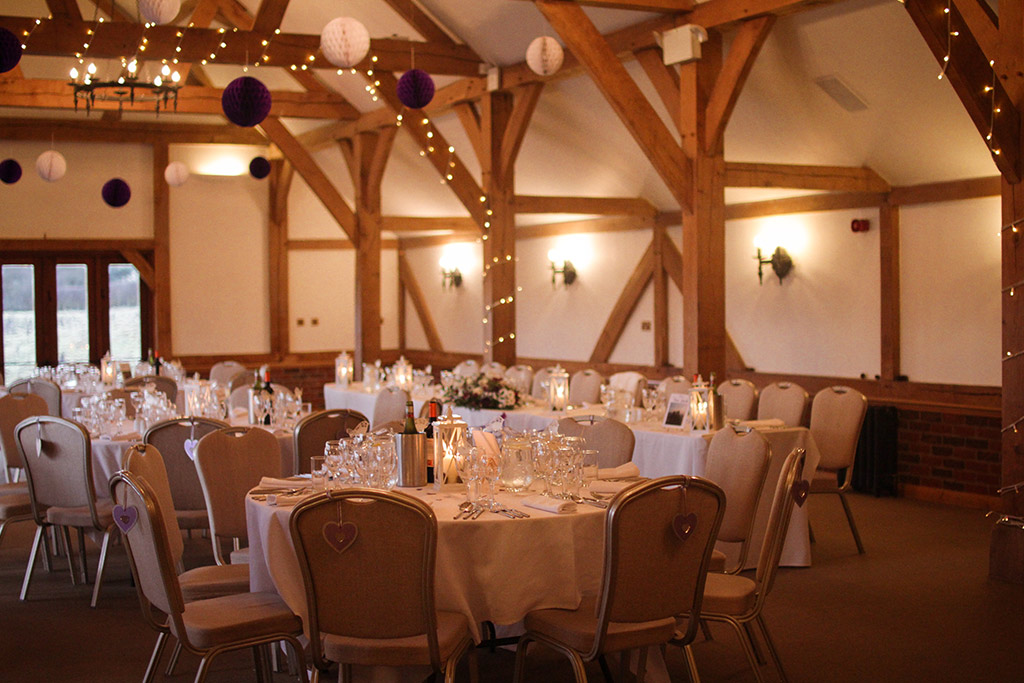 The barn set up for a wedding breakfast at Sandhole Oak Barn
