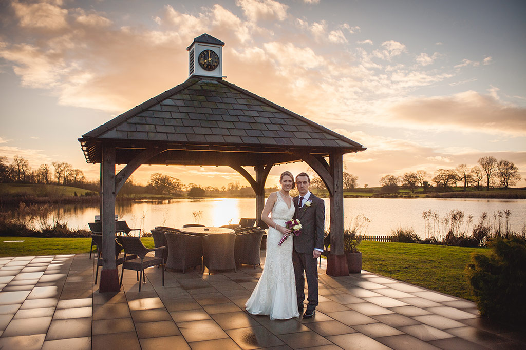 Kirtsy and Richard outside the beautiful Clock Tower at Sandhole Oak Barn