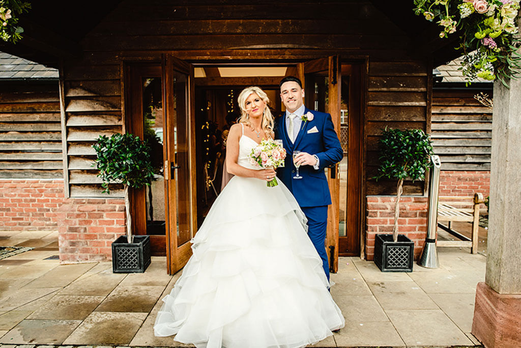 Rebecca and Graeme outside the barn at Sandhole Oak Barn