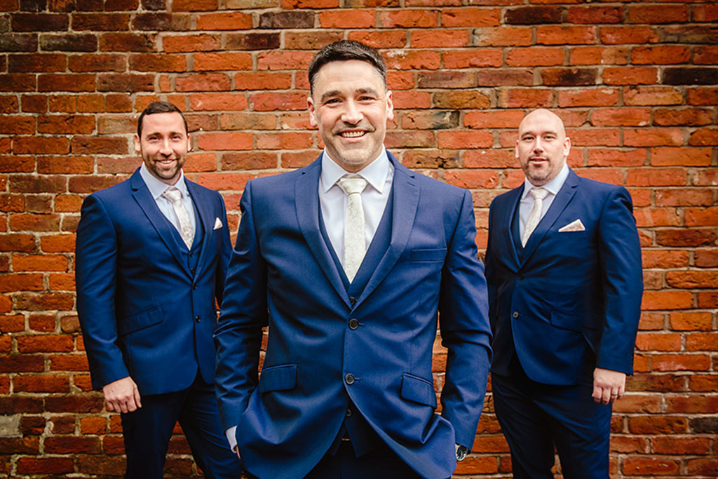 Navy blue suits at Rebecca and Graeme's wedding at Sandhole Oak Barn