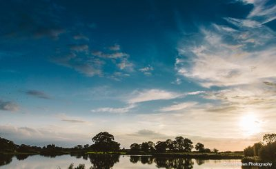 The lake at Sandhole Oak Barn makes for a beautiful countryside wedding setting
