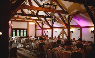 This rustic wedding barn in Cheshire looks beautiful set up for an autumn wedding with pumpkin wedding decorations