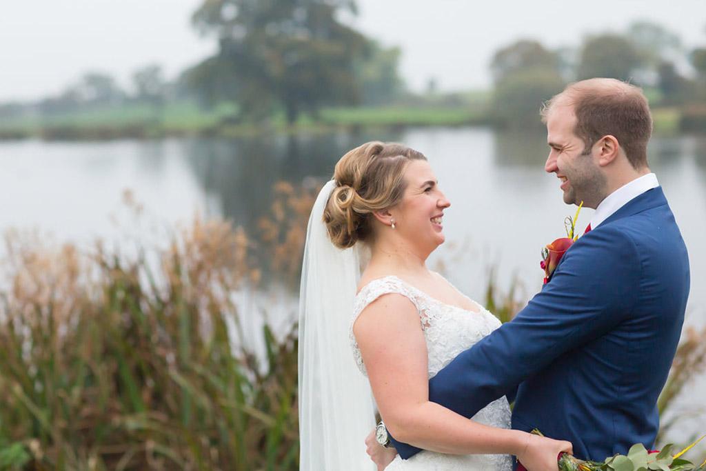 lakeside wedding happy couple sandhole oak barn wedding venues cheshire