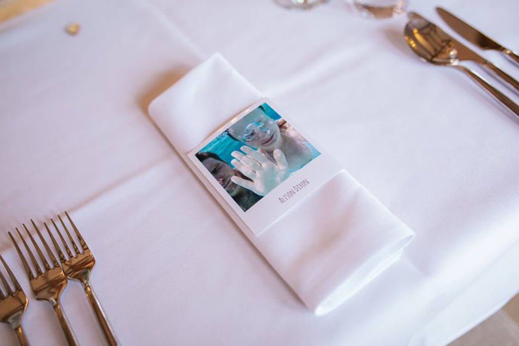 The couple worked hard to find photos of each of their wedding guests as use them for the place names – wedding ideas