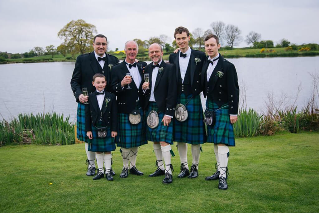 The groomsmen all had a photo together tin their blue tartan kilts – wedding ideas