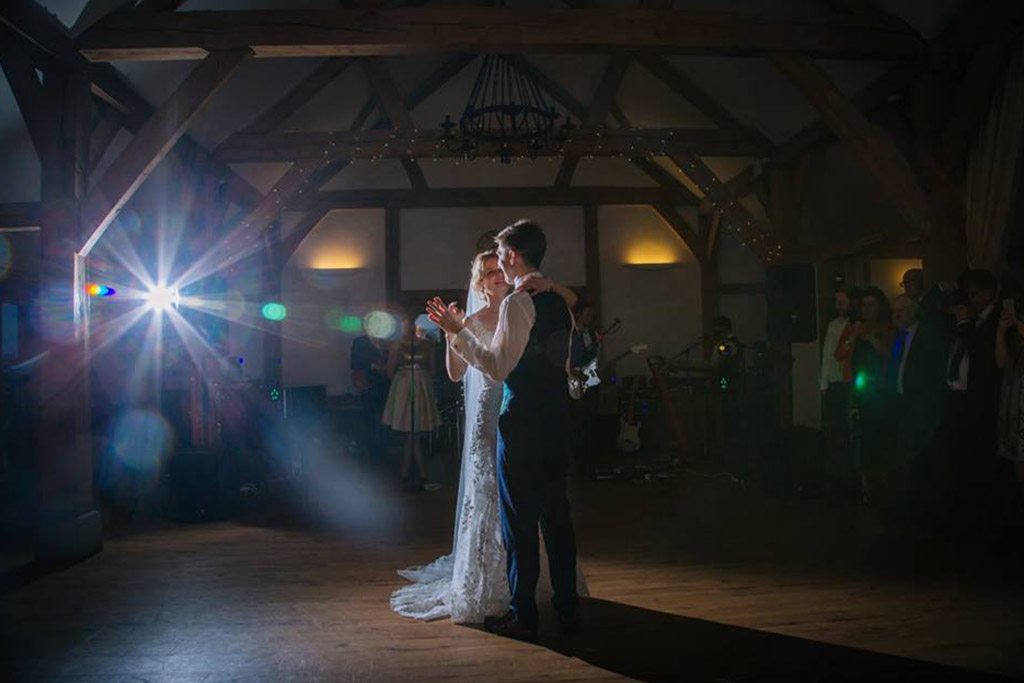 The excited newlyweds take to the dance floor to enjoy their first dance as husband and wife