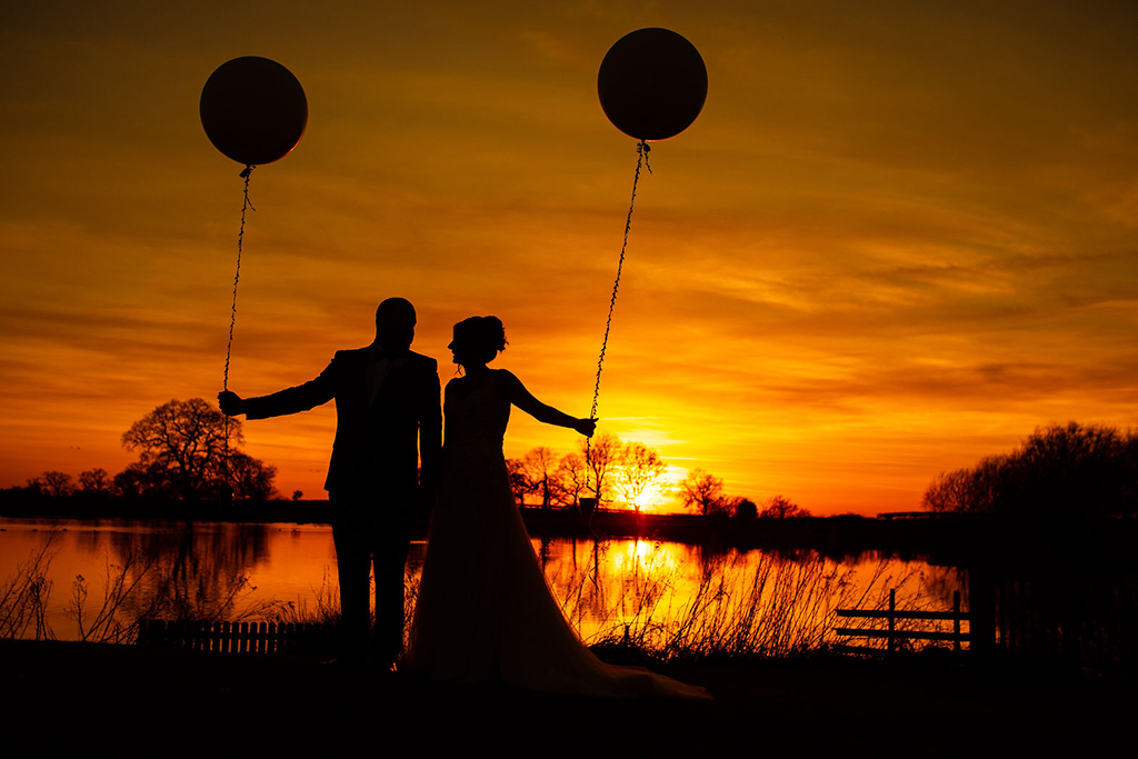 The happy newlyweds have a wedding photo in the sunset at their wedding in Cheshire