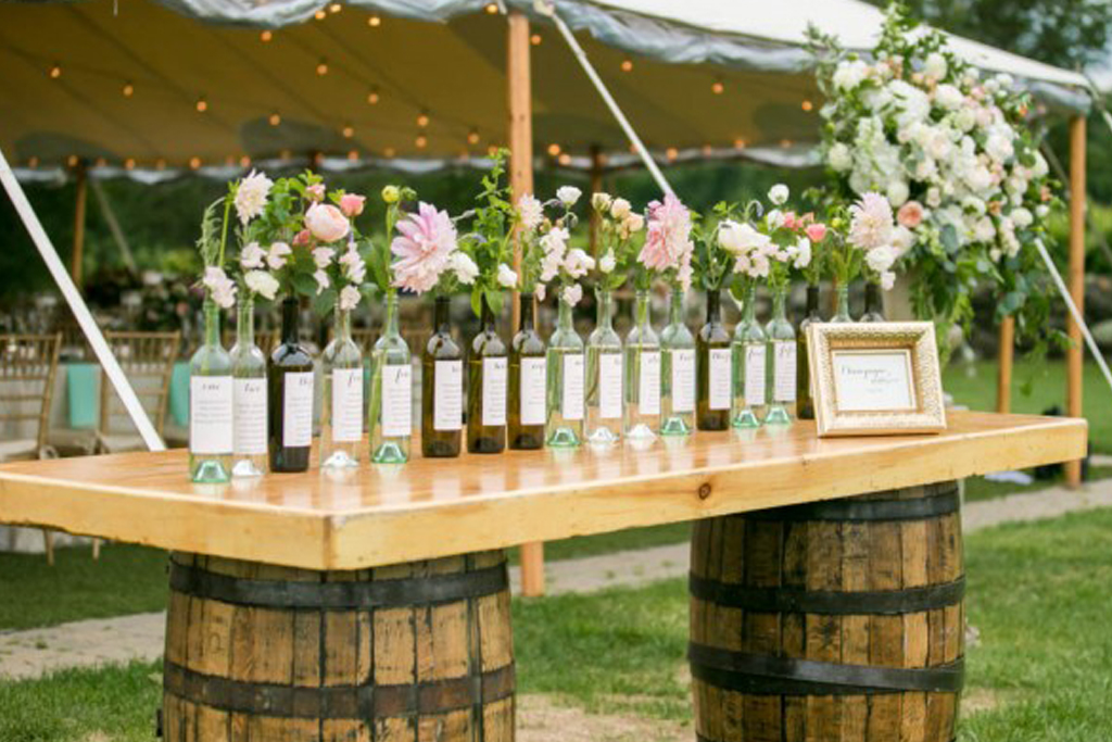A wine bottle table plan is a simple but original idea for your Sandhole Oak Barn wedding