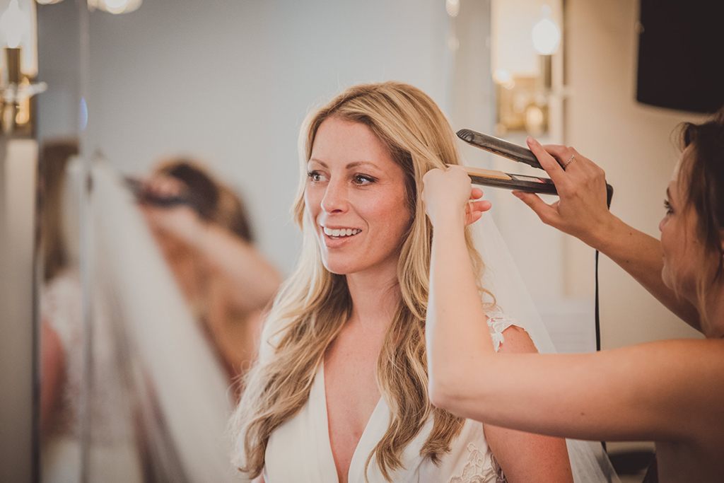 The bride prepares for the wedding ceremony at Sandhole Oak Barn in Cheshire